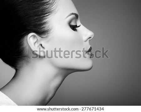 Beautiful woman face. Perfect makeup. Beauty fashion. Eyelashes. Cosmetic Eyeshadow. Black and white - stock photo