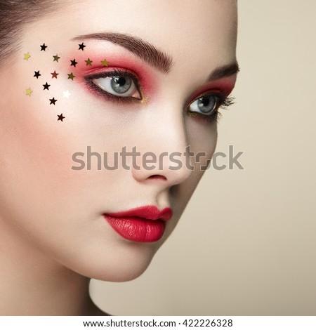 Beautiful woman face. Perfect makeup. Beauty fashion. Eyelashes. Lips. Cosmetic Eyeshadow. Perfect skin - stock photo