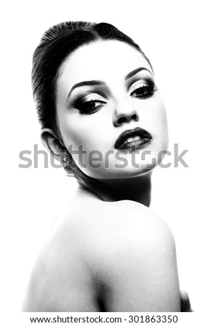 Beautiful woman face. Perfect makeup. Beauty fashion. Portrait of attractive young model with bright make-up. B&W. Fine art.