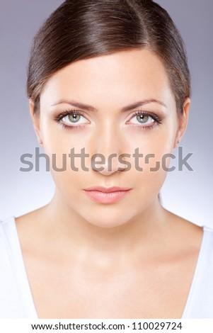 beautiful woman face portrait over blue - stock photo