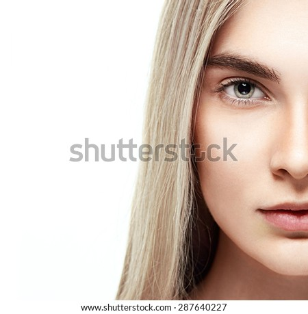 Beautiful woman face studio on white half-face
