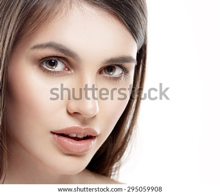 Beautiful woman face studio on white with sexy lips close-up - stock photo