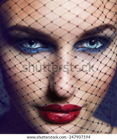 Beautiful woman face with bright glamorous make up. - stock photo