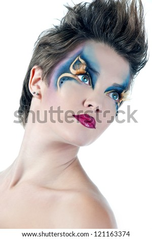 beautiful woman face with Creative Fashion Art make up and eyelashes.