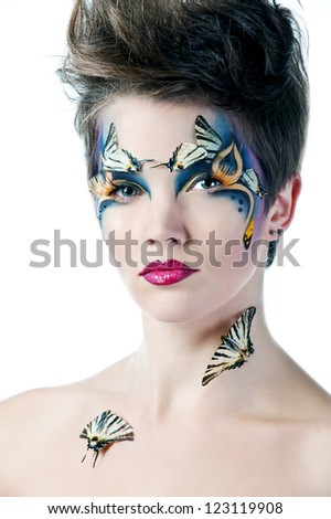 beautiful woman face with Creative Fashion Art make up and eyelashes