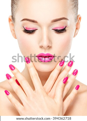 Beautiful woman face with pink makeup of eyes and nails. Glamour fashion model portrait - stock photo