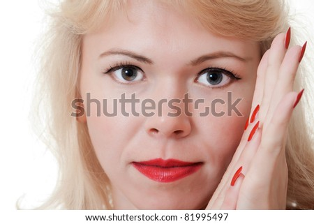 Beautiful woman face with red nails - stock photo