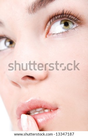 Beautiful woman face with staring shiny eyes close-up - stock photo