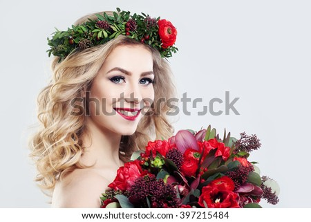 Beautiful Woman Fashion Model with Flowers Bouquet - stock photo