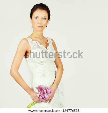 Beautiful woman fashion model with spring flowers - stock photo