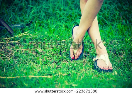 beautiful woman foot on grass - stock photo