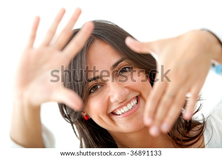 Beautiful woman framing her face with her hands isolated