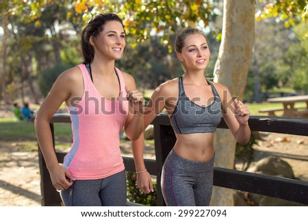 Beautiful woman friends group of joggers running outdoors in nature happy and in shape dieting cardio active - stock photo