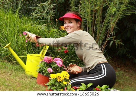 Beautiful woman gardener - stock photo