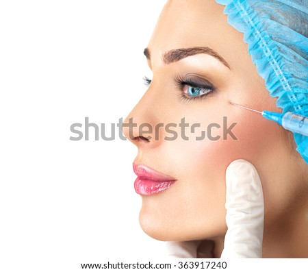Beautiful woman gets beauty facial injections. Face aging injection. Aesthetic Cosmetology - stock photo