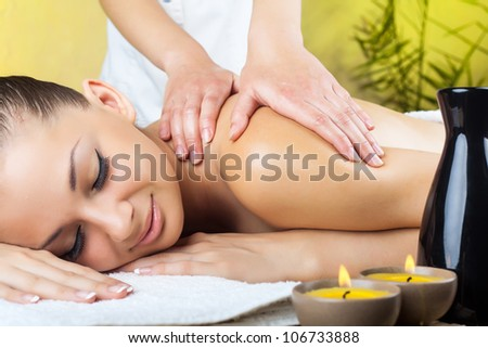 Beautiful woman getting a massage in the spa salon - stock photo