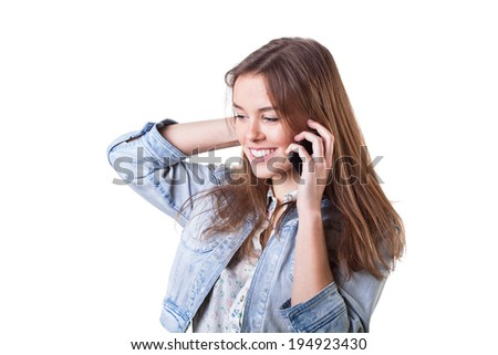 Beautiful woman getting good news on her mobile phone