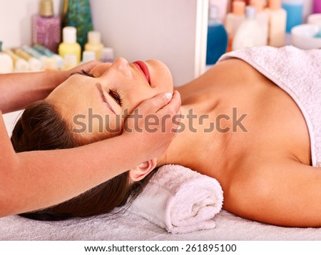 Beautiful woman getting head massage. - stock photo