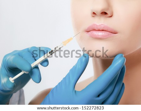 Beautiful woman getting injection in her face
