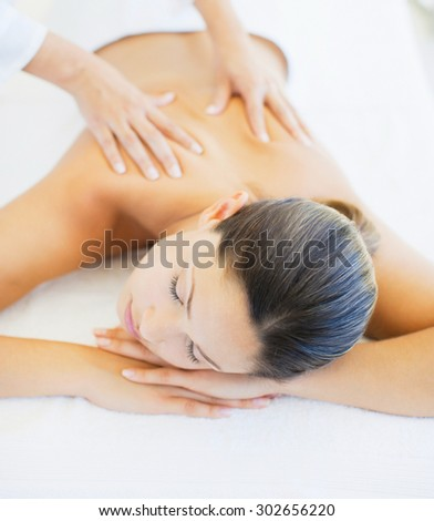 Beautiful Woman Getting Spa Massage in Spa Salon - stock photo