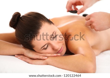 Beautiful woman getting spa massage with hot stones