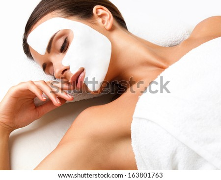 Beautiful Woman Getting Spa Treatment. Cosmetic Mask on Face. Skin Care