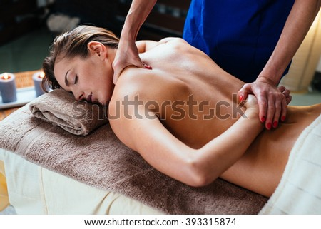 Beautiful woman getting thai massage in spa - stock photo