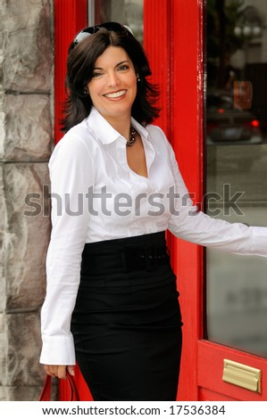 Beautiful Woman  Going Into An Upscale Clothes Boutique - stock photo