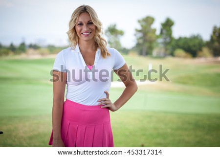Beautiful woman golf caddy on course with copy space