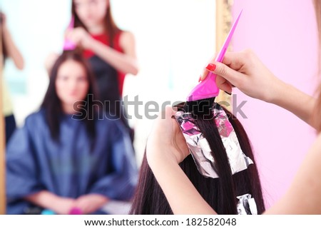 Beautiful woman hairdresser do hairstyle girl in beauty salon - stock photo