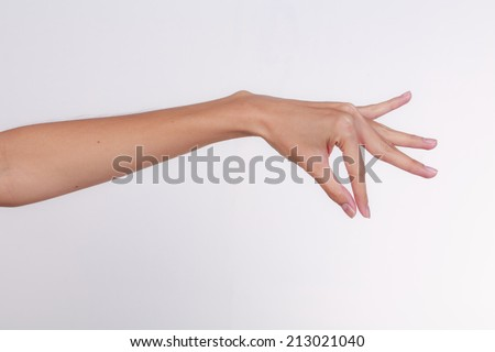 Beautiful woman hand holding items isolated on white background.