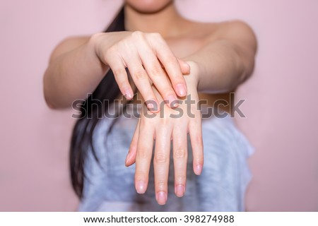 beautiful woman hands apply cream - stock photo