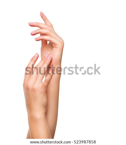 Beautiful Woman Hands. Spa and Manicure concept. Female hands with french manicure. Soft skin, skincare concept. Beauty nails. Isolated on white background