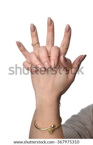 Beautiful woman hands with french manicure nails and fashion jewelry rings beauty for spa salon isolated on a white background - stock photo