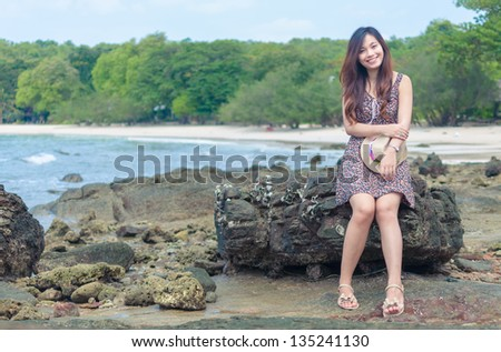Beautiful woman happy on a beach, vintage style - stock photo