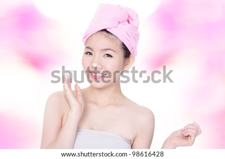 Beautiful woman happy washing face with foam on hands with pink background, model is a asian beauty - stock photo