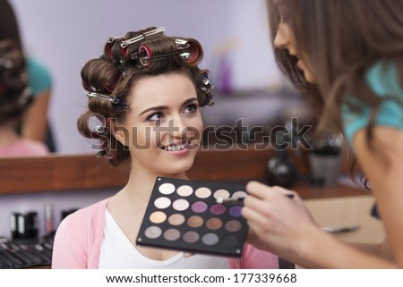 Beautiful woman has her own stylist  - stock photo