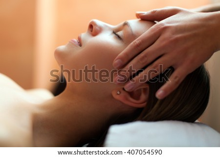 Beautiful woman having an head massage - stock photo