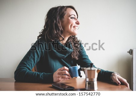 beautiful woman having breakfast at home - stock photo