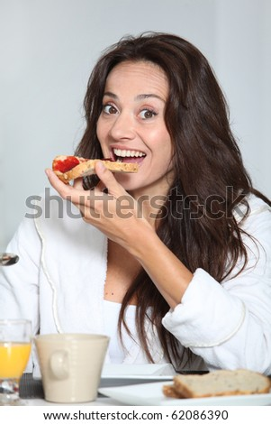 Beautiful woman having breakfast at home
