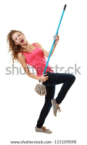 Beautiful woman having fun by playing air guitar with the mop. Isolated on white background. - stock photo
