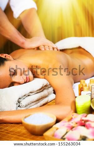 Beautiful woman having relaxing in spa massage salon. - stock photo