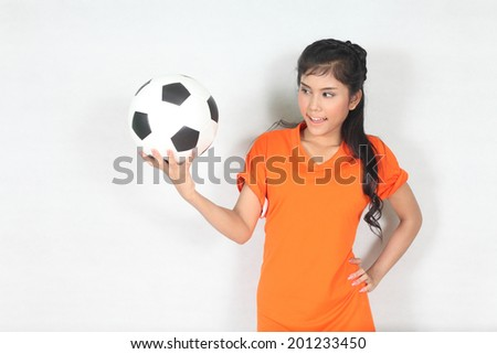 Beautiful woman hold ball with wearing football top  - stock photo