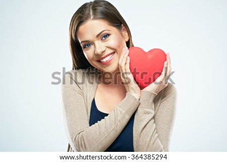 Beautiful woman hold red heart. Valentine day love concept. Studio isolated portrait of smiling woman with long hair. Young model.