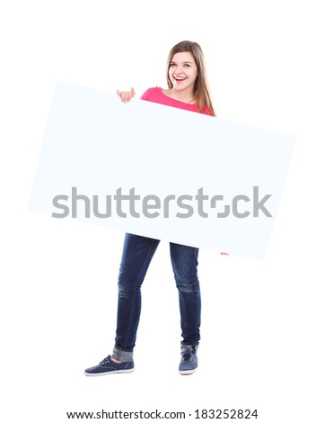 Beautiful woman holding a blank billboard isolated on white background