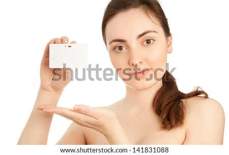 Beautiful woman holding a blank business card isolated on white - stock photo