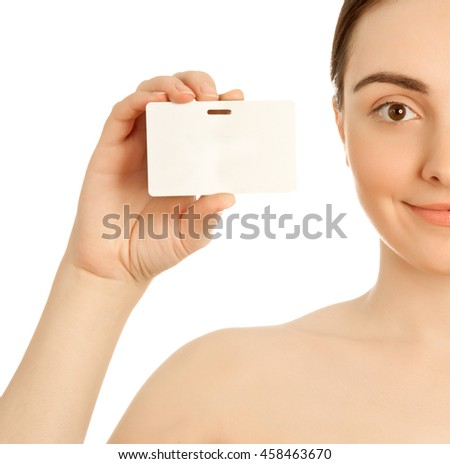Beautiful woman holding a blank business card isolated on white