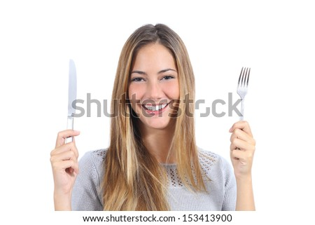 Beautiful woman holding a fork and a table knife isolated on a white background                 - stock photo