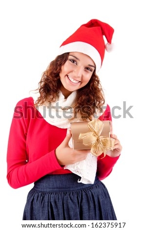 Beautiful woman holding a gift for christmas