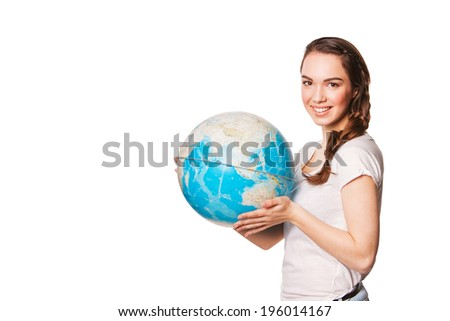 beautiful  woman holding a globe in his hands